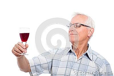 Senior man tasting wine