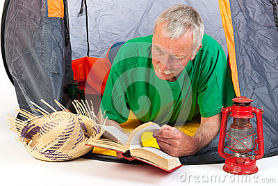 Senior man by tent
