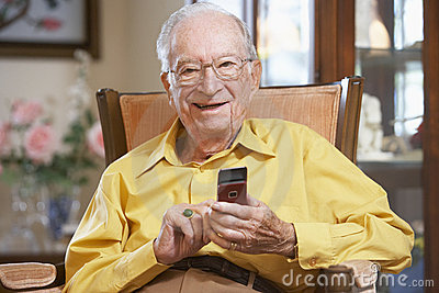 Senior man texting on mobile phone