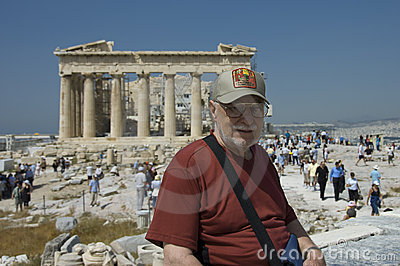 Senior man and  tourists in Parthenon Editorial Image