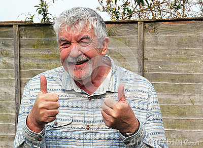 Senior man with two thumbs up, ok sign.