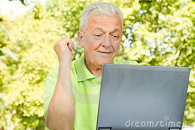 Senior man using laptop
