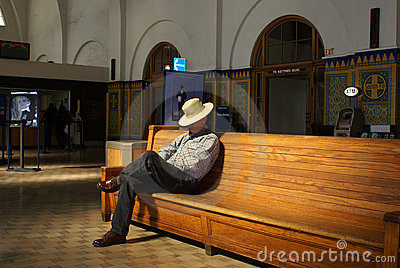 Senior Man Waiting in Train Station