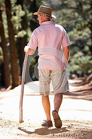 Senior man on walking along a country lane