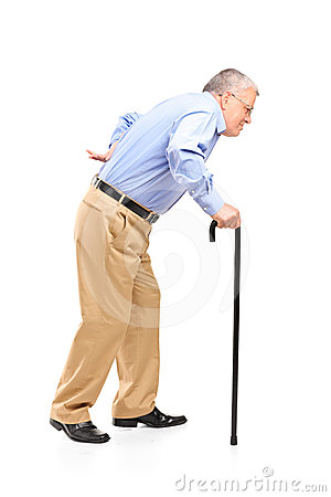 Senior man walking with cane
