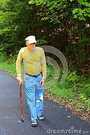 Free Senior Man Walking With Cane Stock Photo - 44896930