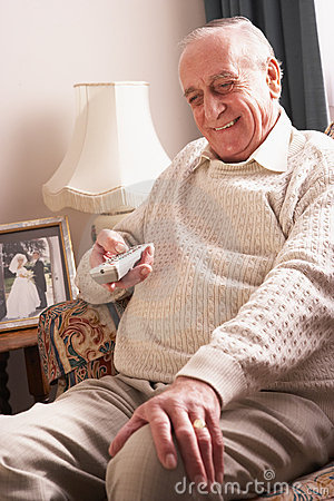 Senior Man Watching TV At Home