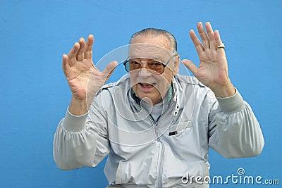 Senior man waving his hands