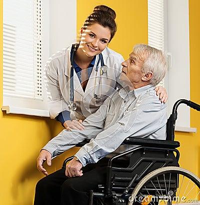 With senior man in wheelchair