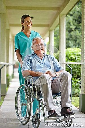 Senior man in wheelchair with nurse