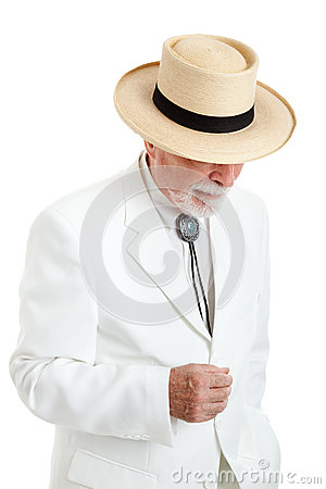 Senior Man in White Suit and Panama Hat