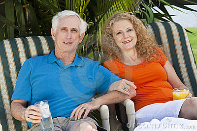 Senior Man and Woman Couple Enjoying Drinks