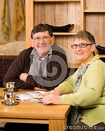 Senior man and woman couple looking at brochure