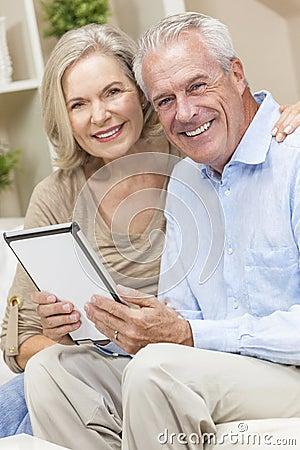 Senior Man & Woman Couple on Tablet Computer