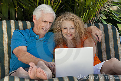 Senior Man and Woman Couple Using Laptop Computer