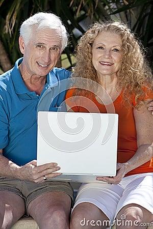 Senior Man & Woman Couple Using Laptop Computer
