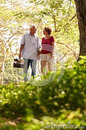 Free Senior Man Woman Old Couple Walking With Picnic Basket Royalty Free Stock Photos - 74217228