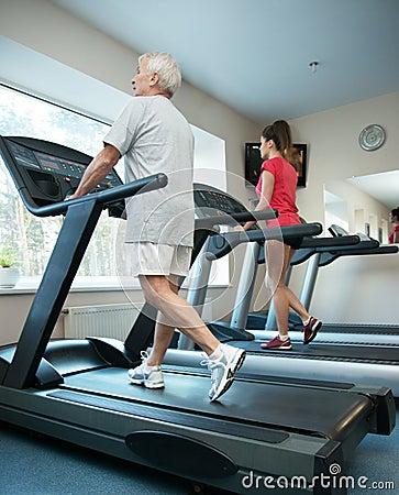 Senior man and woman on a treadmill