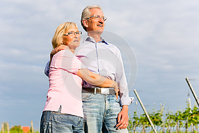 Senior man and woman walking hand in hand