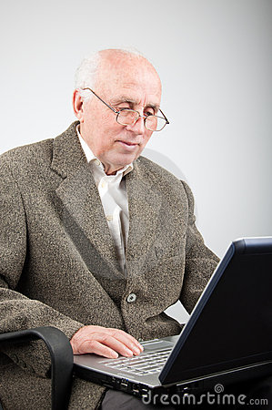 Senior man working on computer