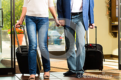 Senior married couple arriving at Hotel