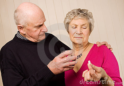 Senior mature couple taking pain medication