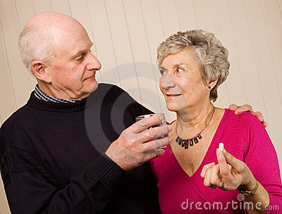 Senior mature couple taking pain medication
