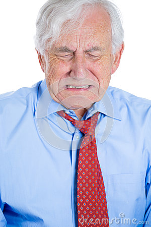 Senior mature, elderly man very sad and depressed and almost to the point of crying