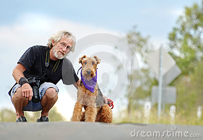 Senior mature man & pet dog on walk outdoors