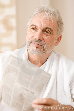 Free Senior Mature Man Thoughtful Read Newspaper Royalty Free Stock Photos - 18220478