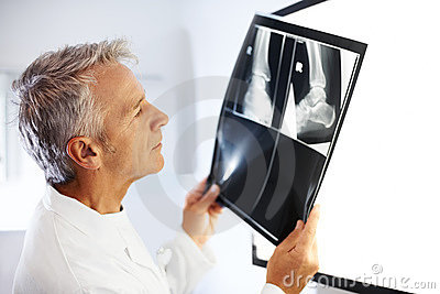 Senior medical doctor checking X-Ray