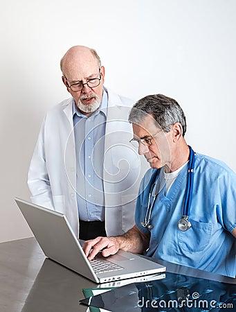 Senior Medical Doctors Discussing Patient s MRI Film Scans