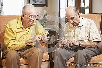 Senior men text messaging