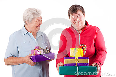 Senior and mental disabled woman holding gift