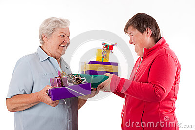 Senior and mental disabled woman holding gifts