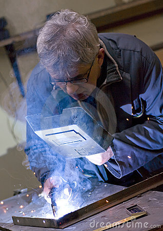 Senior metalworker welding