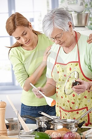 Senior mother cooking with daughter