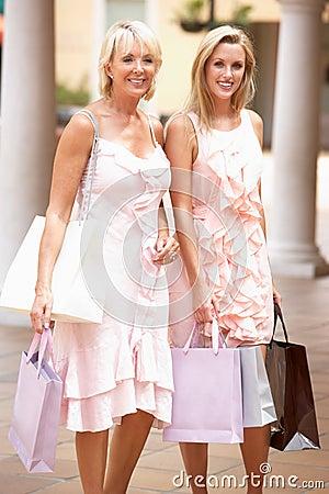 Senior Mother And Daughter Enjoying Shopping