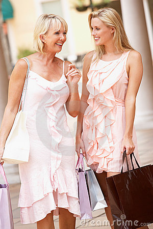 Senior Mother And Daughter Enjoying Shopping