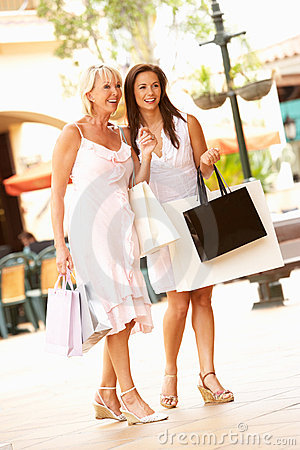 Senior Mother And Daughter Enjoying Shopping Trip
