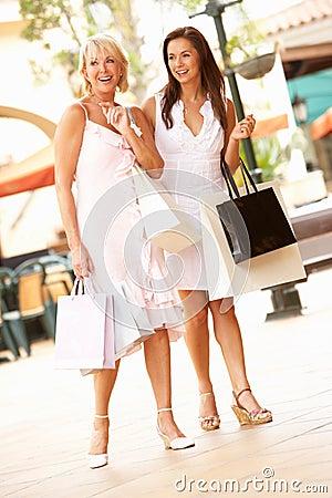 Senior Mother And Daughter Enjoying Shopping Trip