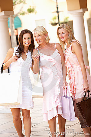 Senior Mother And Daughters Enjoying Shopping
