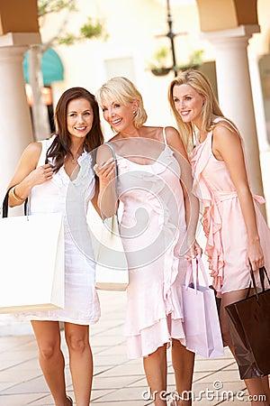 Senior Mother And Daughters Enjoying Shopping