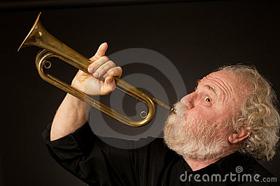 Senior musician playing a bugle