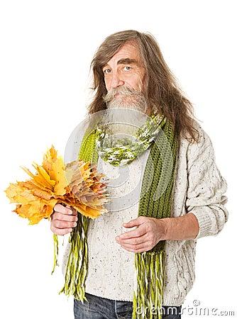 Senior old man holding autumn yellow  maple leaves