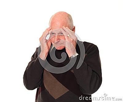 Senior older man holding head with stress headache