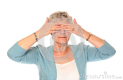 Senior older woman covering eyes
