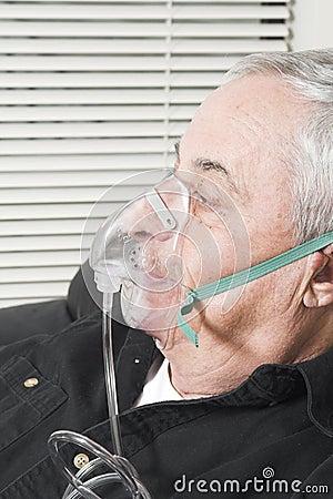 Senior with oxygen mask