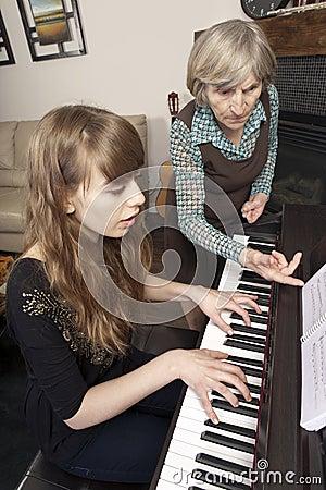 Senior paino teacher and student