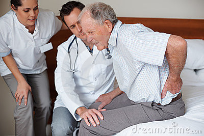 Senior patient with a backache at the hospital